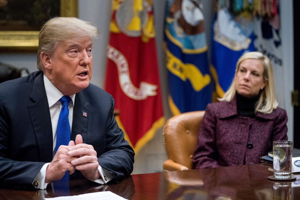 FILE- In this Thursday, Jan. 4, 2018, file photo, President Donald Trump, accompanied by Secretary of Homeland Security Kirstjen Nielsen, right, speaks during a meeting with Republican Senators on immigration in the Roosevelt Room at the White House in Washington. The Trump administration faces a Monday, Jan. 7, deadline on whether to extend protections that would allow nearly 200,000 Salvadorans to stay in the U.S. legally. Nielsen, who is tasked with making the decision, told the Associated Press last week that short-term extensions are not the answer. (AP Photo/Andrew Harnik, File)