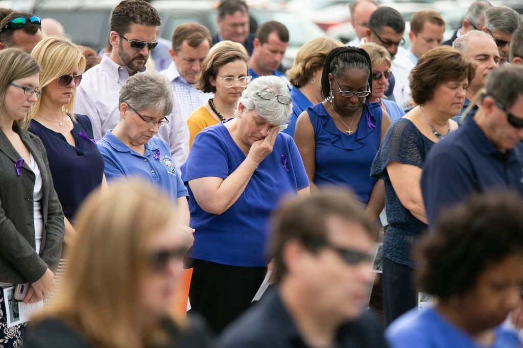 Mourners take a moment of silence during a memorial service for Christopher K. Rapp and the victims of the Virginia Beach shootings, Wednesday, June 5, 2019, in Stafford, Va. Rapp, a former Stafford County, Va., employee who was one of 12 killed in the May 31, shooting at the Virginia Beach Municipal Center in Virginia Beach, Va. (Mike Morones/The Free Lance-Star via AP)
