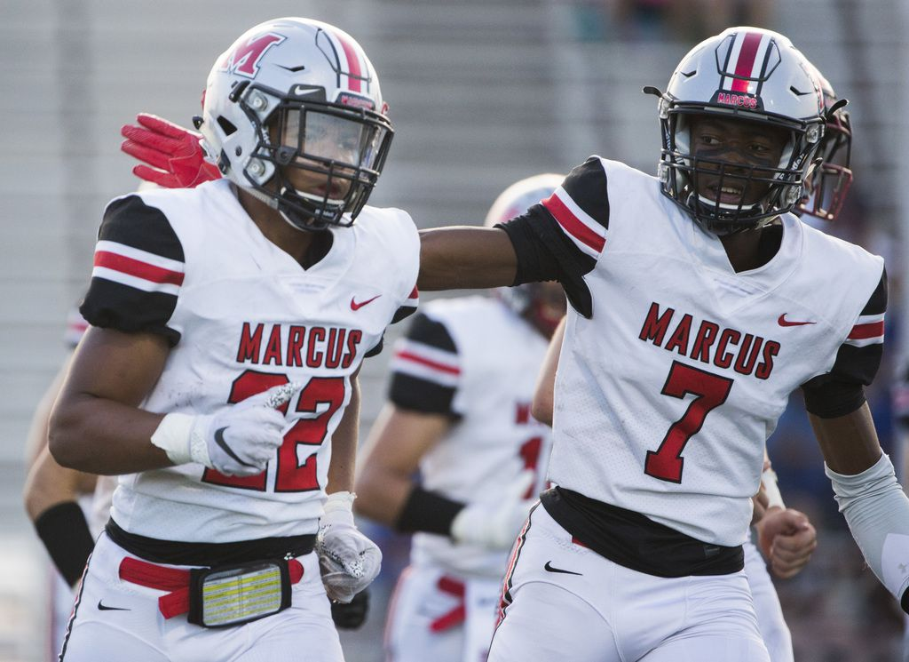 Flower Mound Marcus running back Ty'son Edwards (22) gets a pat on the back from wide receiver J. Michael Sturdivant (7) after Edwards scored a touchdown during the first quarter of a high school football game between Flower Mound Marcus and Arlington Bowie on Thursday, August 29, 2019 at Wilemon Field in Arlington. (Ashley Landis/The Dallas Morning News)