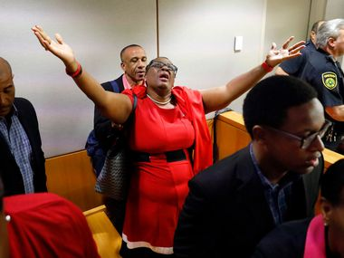 Botham Jean's mother, Allison Jean, rejoices in the courtroom after fired Dallas police Officer Amber Guyger was found guilty of murder Tuesday by a Dallas County jury.