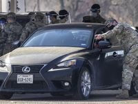 National Guard troops direct cars at a FEMA vaccination site set up for residents from high-risk zip codes at Fair Park on Wednesday, Feb. 24, 2021, in Dallas. The FEMA vaccine site opened at Fair Park Wednesday with the goal of vaccinating 3,000 people a day who live in any of the 17 zip codes identified as high risk. (Lynda M. González/The Dallas Morning News)