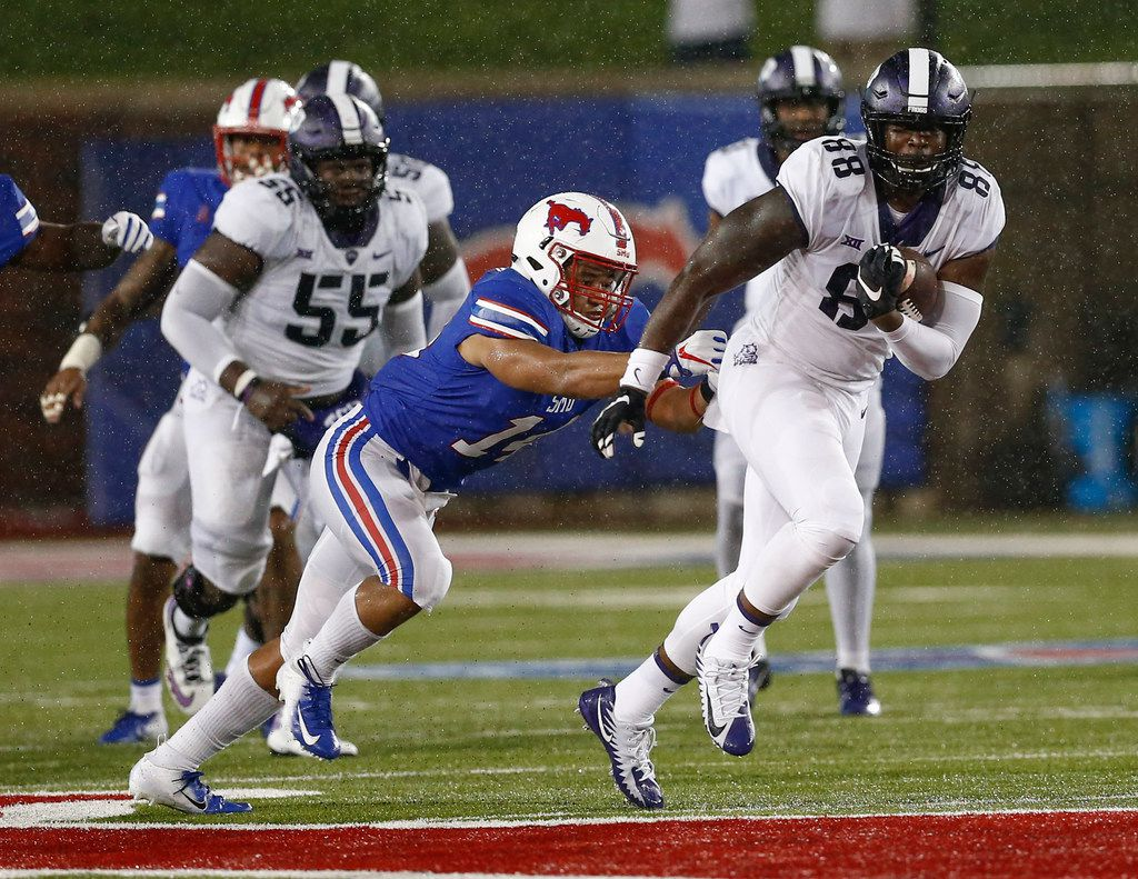 FILE - TCU tight end Artayvious Lynn (88) tries to get away form SMU linebacker Richard Moore (14) after a reception during the second quarter of an NCAA college football game Friday, Sept. 7, 2018, in Dallas. (AP Photo/Jim Cowsert)