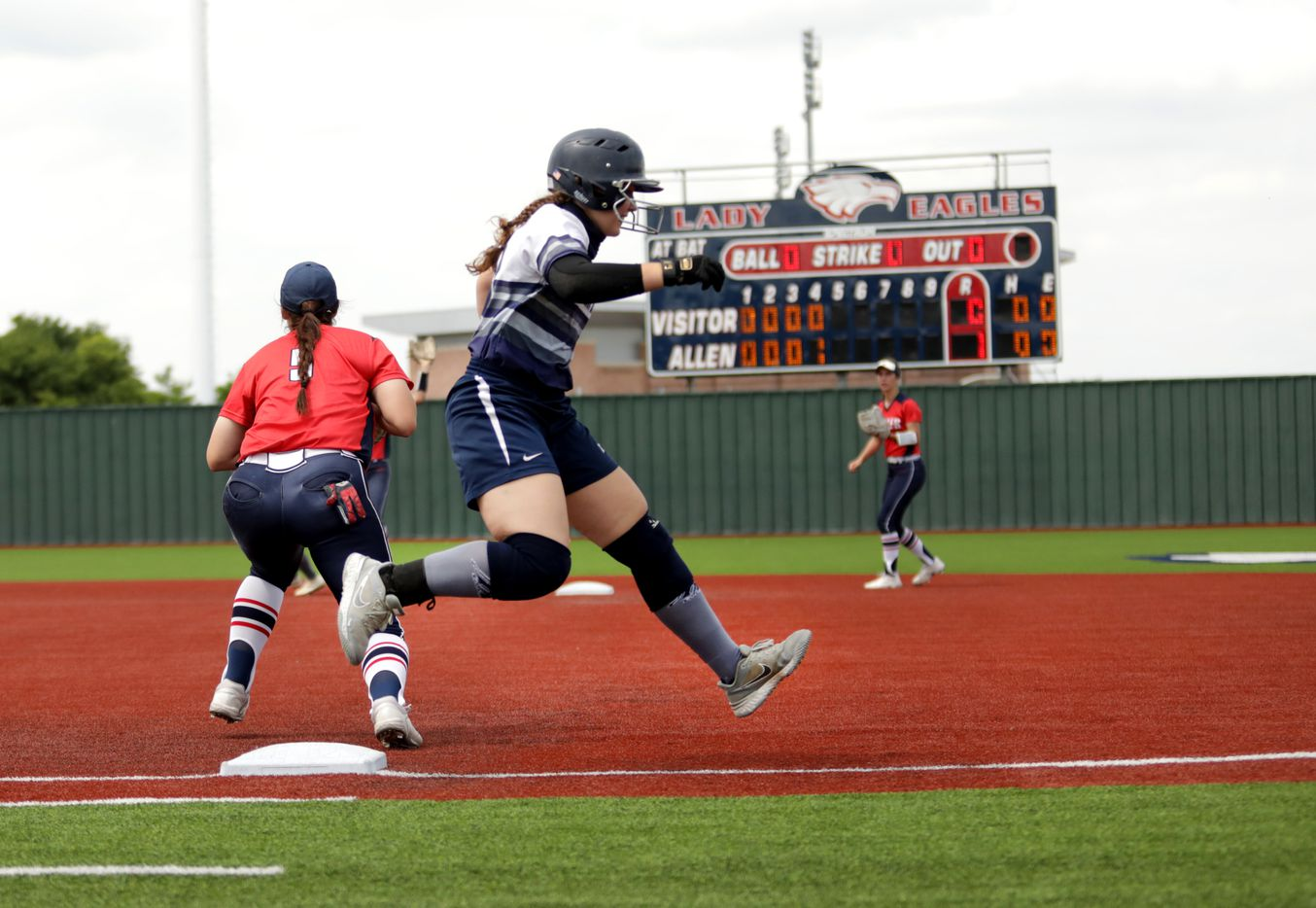 Flower Mound High School player #20, Katie Cantrell, runs past first base during a softball game against Allen High School at Allen High School in Allen, TX, on May 15, 2021. (Jason Janik/Special Contributor)