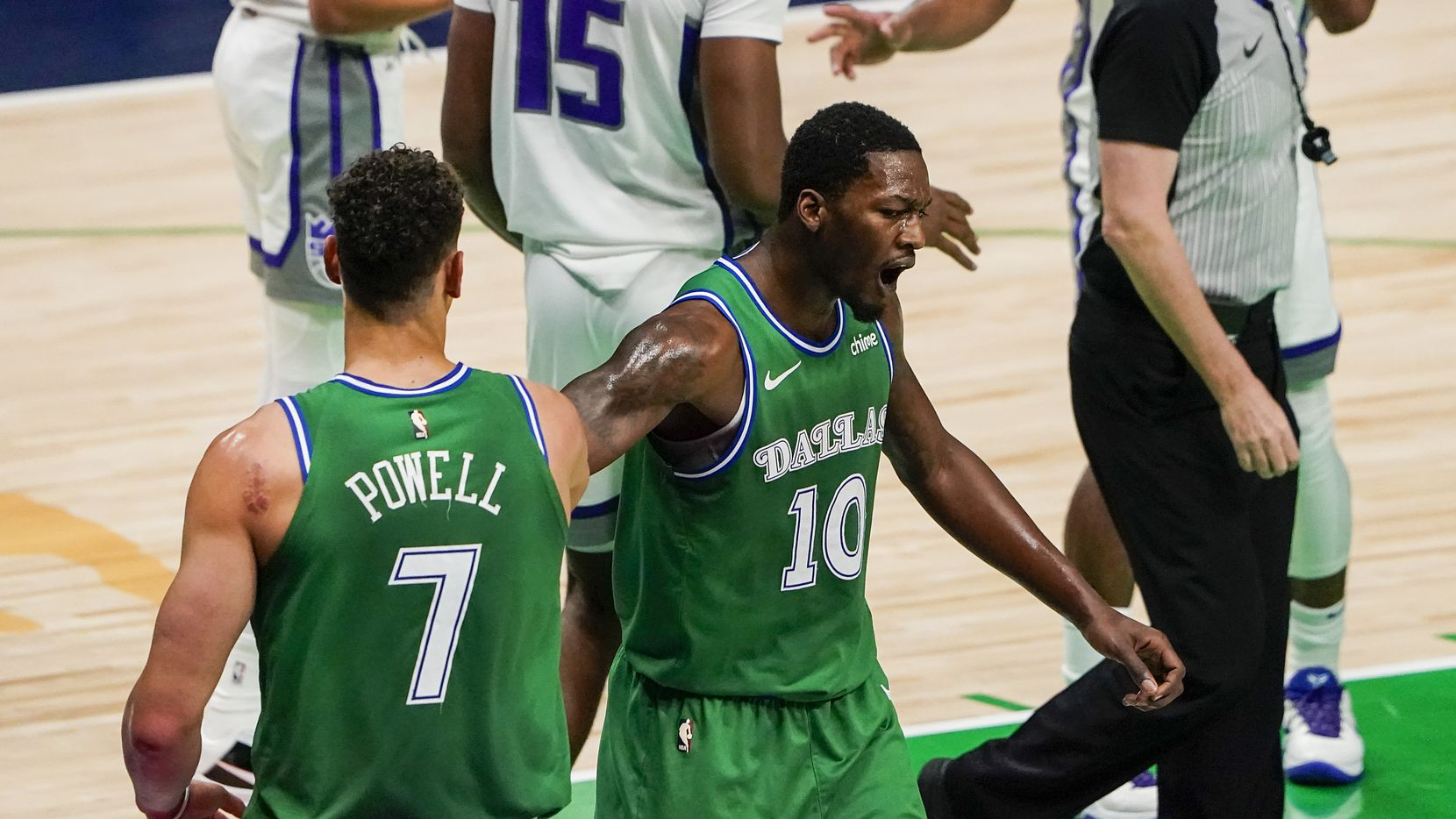 Dallas Mavericks forward Dorian Finney-Smith (10) celebrates a basket by center Dwight Powell (7) during the first half of an NBA basketball game against the Sacramento Kings at American Airlines Center on Sunday, May 2, 2021, in Dallas.
