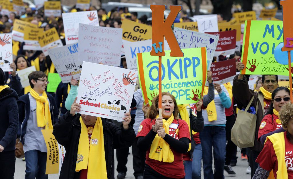 Students, teachers and supporters march on the grounds of the Texas Capitol, Friday, Jan. 30, 2015, in Austin, Texas. (AP Photo/Eric Gay)
