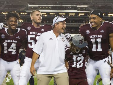 Texas A&M Aggies head coach Jimbo Fisher, joined by his son Ethan Fisher (wearing jersey number 12), celebrates with the team after beating the Northwestern State Demons 59-7 on Thursday, August 30, 2018 at Kyle Field in College Station, Texas.