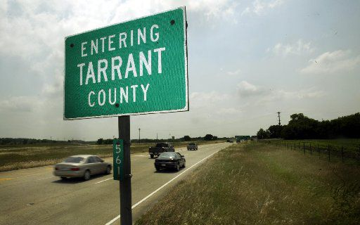 A sign along  State Highway 170  in Westlake informs motorist they are entering Tarrant County Wednesday May 11, 2005.