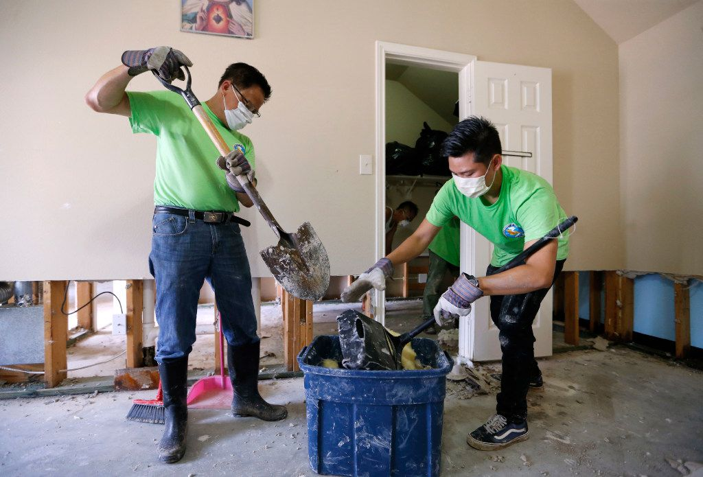 Tinh Truong, secretary for the Vietnamese Community of Houston and Vicinities and Khoa Nguyen of San Jose work on cleaning a bedroom at the home of Chan Van Nguyen in Katy, Texas on Monday, September 4, 2017. Volunteers from the Vietnamese Community of Houston and Vicinities helped clean out and prepare houses after the flooding caused by hurricane Harvey. (Vernon Bryant/The Dallas Morning News)