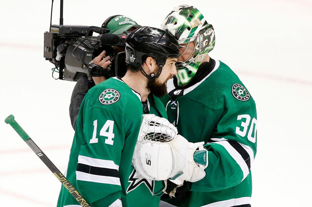 Dallas Stars left wing Jamie Benn (14) congratulates goaltender Ben Bishop (30) on their 4-2 win over the St. Louis Blues at the American Airlines Center in Dallas, Wednesday, May 1, 2019. The teams were playing Western Conference Second Round Game 4 of the 2019 NHL Stanley Cup Playoffs. (Tom Fox/The Dallas Morning News)