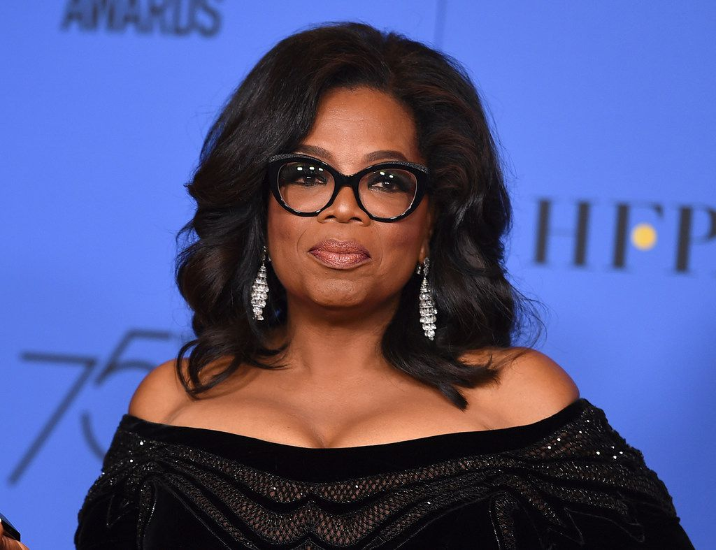 In this Jan. 7, 2018 file photo, Oprah Winfrey poses in the press room with the Cecil B. DeMille Award at the 75th annual Golden Globe Awards in Beverly Hills, Calif. Winfrey was one of about five dozen people cut from Texas' social studies curriculum after the State Board of Education streamlined its K-12 history standards.