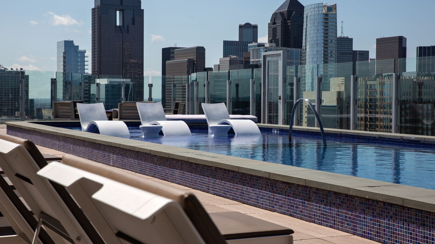 The pool deck of the 20-story One Uptown residential tower on McKinney Avenue in Dallas, which is converting to condominiums.