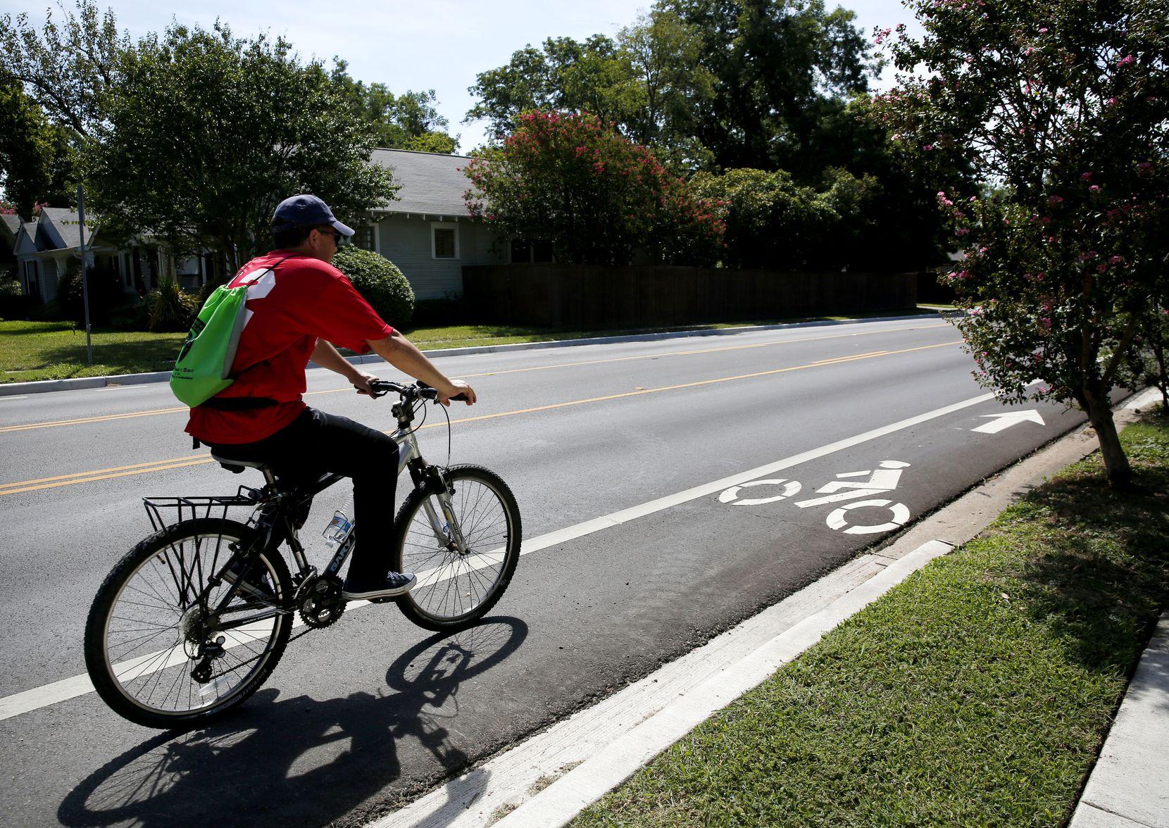 Felipe Garcia rides down a bike lane on Matilda Street in Dallas.
