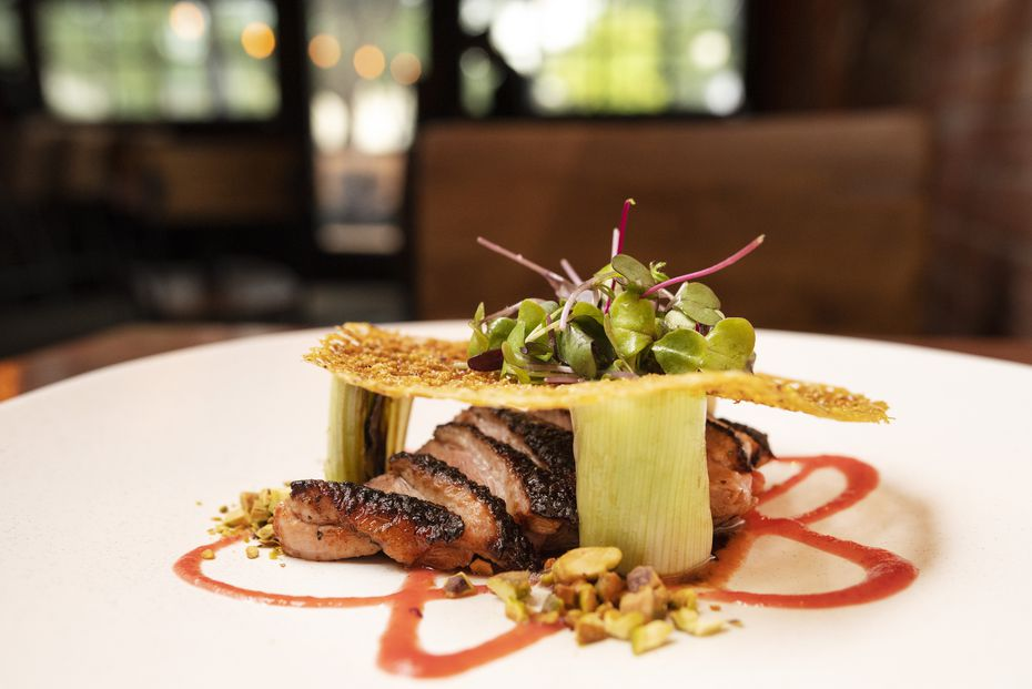 Release the Quack-en at Rye in Dallas is a citrus brined duck dish served with charred leeks, strawberry boshi, pomegranate vinaigrette and pistachio.