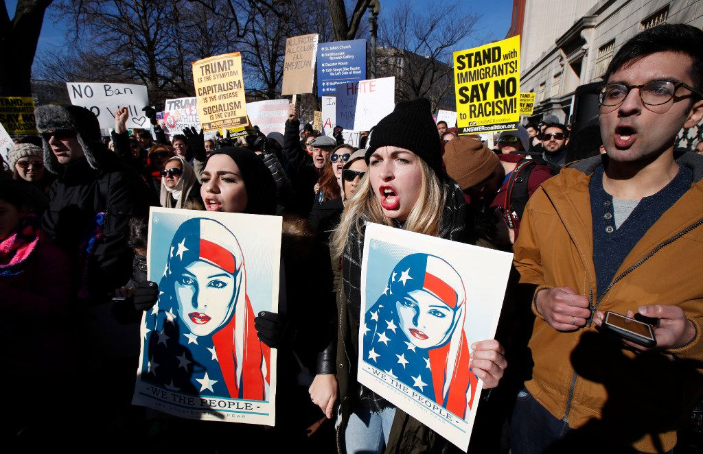 People chant during a rally protesting the immigration policies of President Donald Trump, near the White House in Washington, Saturday, Feb. 4, 2017. (AP Photo/Manuel Balce Ceneta)