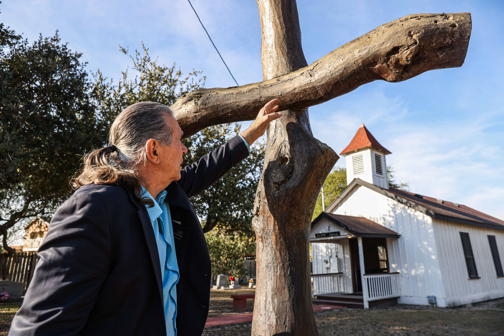 Ramiro Ramirez, 72, talks about how he built a cross with wood that he collected from his ranch for the the United Methodist Jackson Chapel and the historical legacy his family has in the lands near the border with Mexico in Pharr, Texas on Wednesday, January 13, 2021.