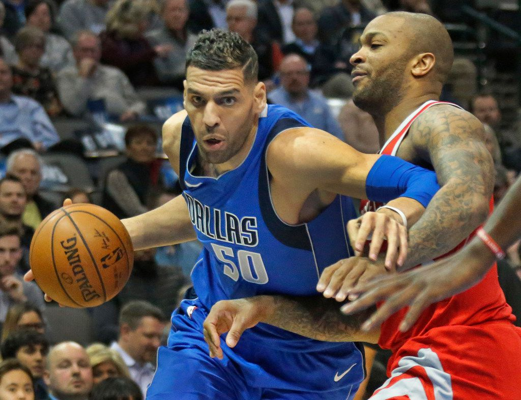Dallas Mavericks center Salah Mejri (50) works around Rockets forward PJ Tucker (4) during the Houston Rockets vs. the Dallas Mavericks NBA basketball game at the American Airlines Center in Dallas on Wednesday, January 24, 2018. (Louis DeLuca/The Dallas Morning News)