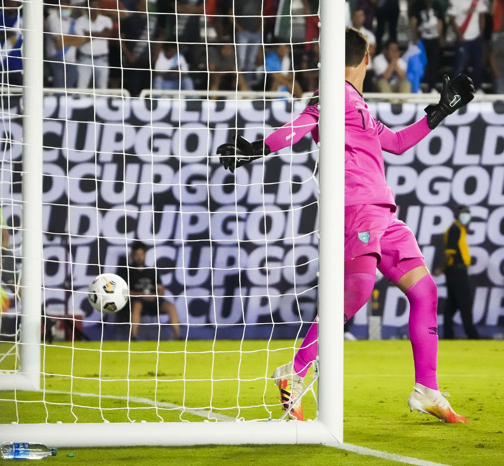 A shot by Mexico midfielder Orbelin Pineda gets past Guatemala goalkeeper Nicholas Hagen (1) for a goal during the second half of a CONCACAF Gold Cup Group A soccer match at the Cotton Bowl on Wednesday, July 14, 2021, in Dallas.