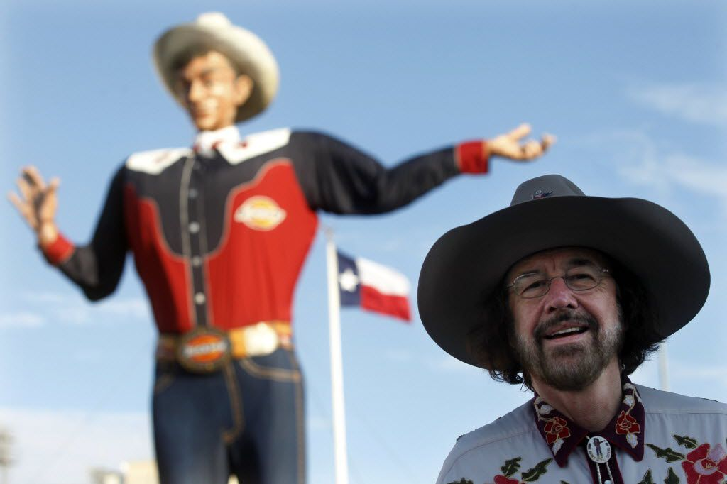 Bill Bragg stands in front of Big Tex at the State Fair of Texas in 2012. Bragg served as the voice of the iconic statue from 2002 to 2013.