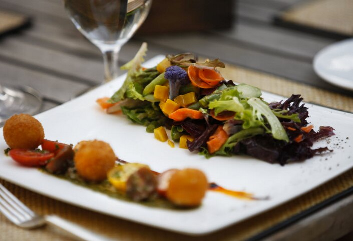 Here's a 2012 dish: Chef Dean Fearing's Farm to Fearing's Vegetable Salad, made with Paula's goat cheese croquettes, greens, smoked pecans and sherry vinaigrette.