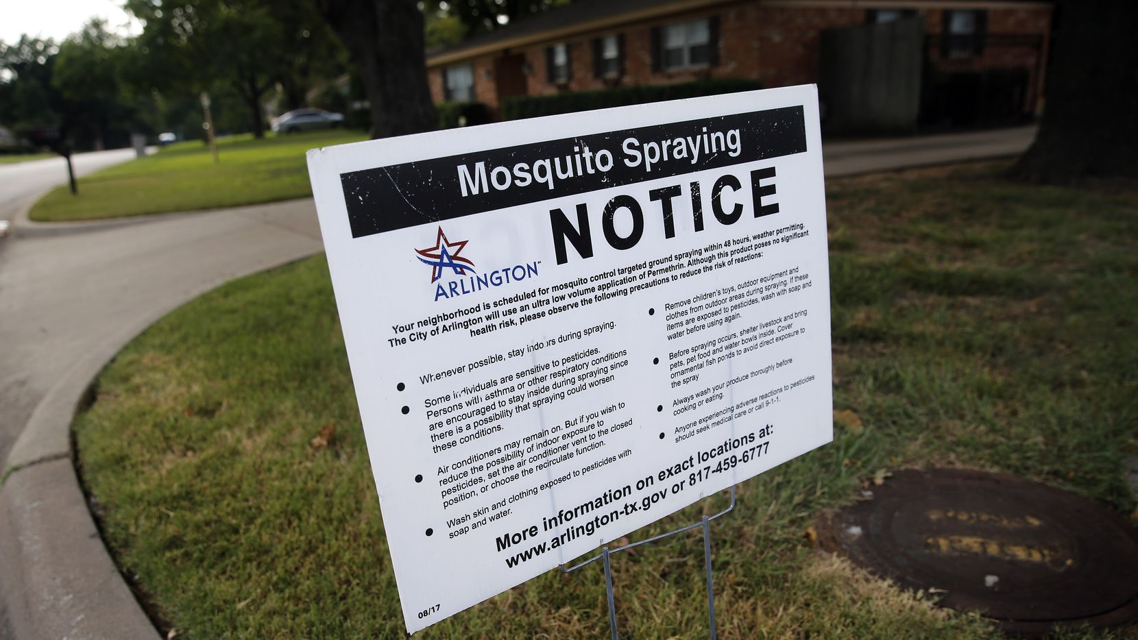 A City of Arlington yard sign alerts residents in North Arlington of mosquito spraying to prevent the West Nile virus in Arlington, Texas, Wednesday, August 5, 2020.
