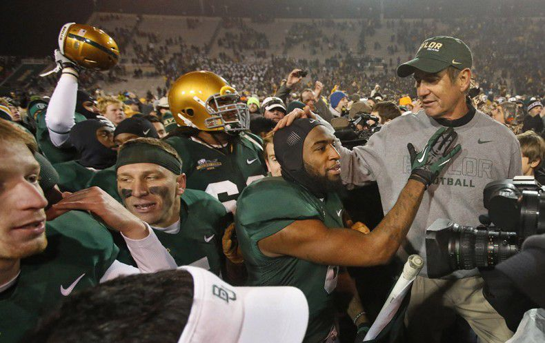 Coach Art Briles shares a moment of affection with safety Ahmad Dixon after the Bears beat Texas 30-10 on Dec. 7, 2013. (Louis DeLuca/The Dallas Morning News)
