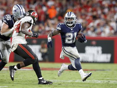 Dallas Cowboys running back Ezekiel Elliott (21) receives a block from tight end Dalton Schultz (86) against the Tampa Bay Buccaneers during the third quarter at Raymond James Stadium in Tampa, Florida, Thursday, September 9, 2021. The Cowboys faced the Tampa Bay Buccaneers in the NFL season opener.