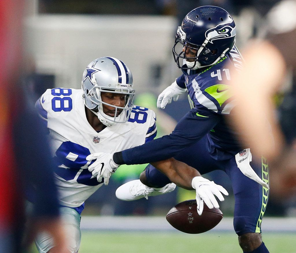 Dallas Cowboys wide receiver Dez Bryant (88) fumbles the ball as he is defended by Seattle Seahawks cornerback Byron Maxwell (41) during the first half of play at AT&T Stadium in Arlington, Texas on Sunday, December 24, 2017. (Vernon Bryant/The Dallas Morning News)