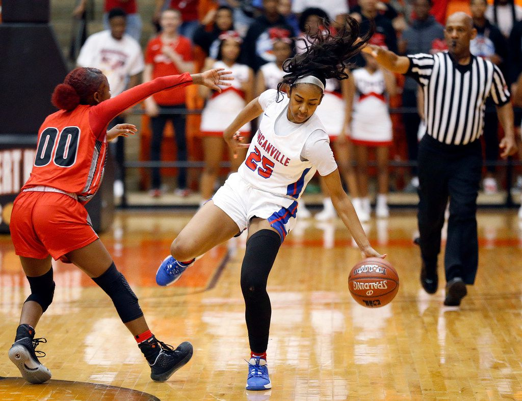 Duncanville's Deja Kelly (25) is fouled by Cedar Hills' Makalah Robinson (00) as she tries to bring the ball across mid court during the second half of the Class 6A Region I championship game at Wilkerson-Greines Activity Center in Fort Worth, Saturday, February 29, 2020. Duncanville won the title game, 56-54. (Tom Fox/The Dallas Morning News)