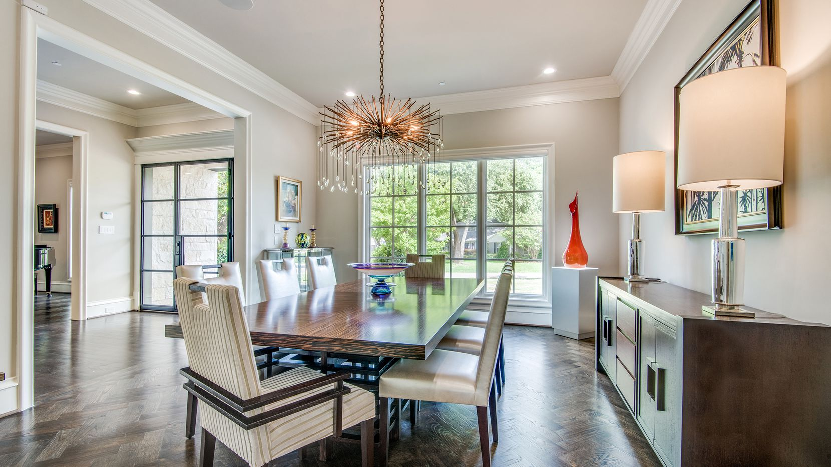 Designed by Richard Drummond Davis, the home at 9110 Rockbrook Drive features five bedrooms, contemporary finishes and a pool.