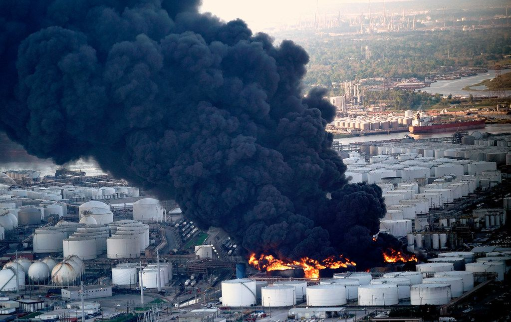 A plume of smoke rises from a petrochemical fire at the Intercontinental Terminals Company Monday, March 18, 2019, in Deer Park, Texas. The large fire at a Houston-area petrochemicals terminal will likely burn for another two days, authorities said Monday, noting that air quality around the facility was testing within normal guidelines.