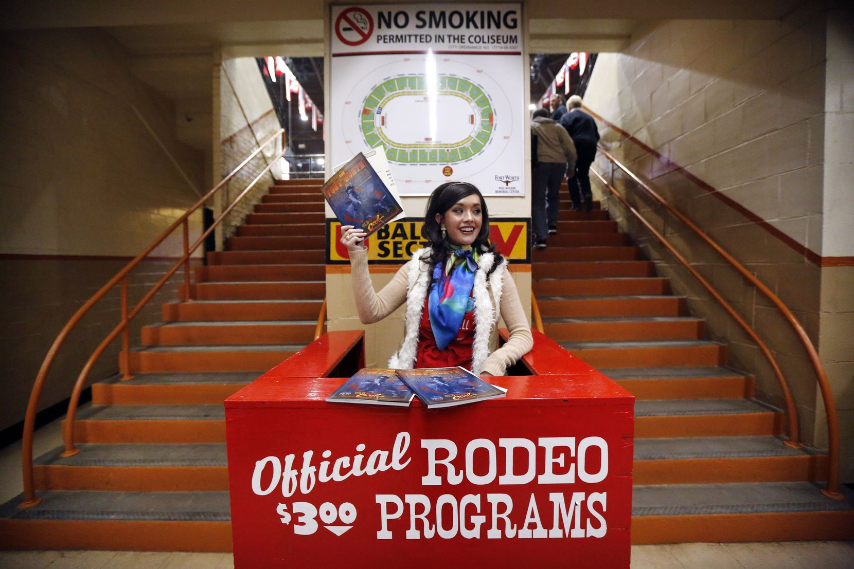 DaNae Lowe and fellow Junior League of Fort Worth members hawk rodeo programs from their red perches lining the concourse of Will Rogers Memorial Coliseum.