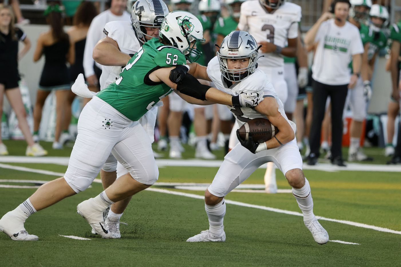 Southlake defender Cade Parks (52) stops Arlington Martin receiver Trey Cochran (2) during a high school football game in Southlake, Texas on Friday, Sept. 17, 2021. (Michael Ainsworth/Special Contributor)