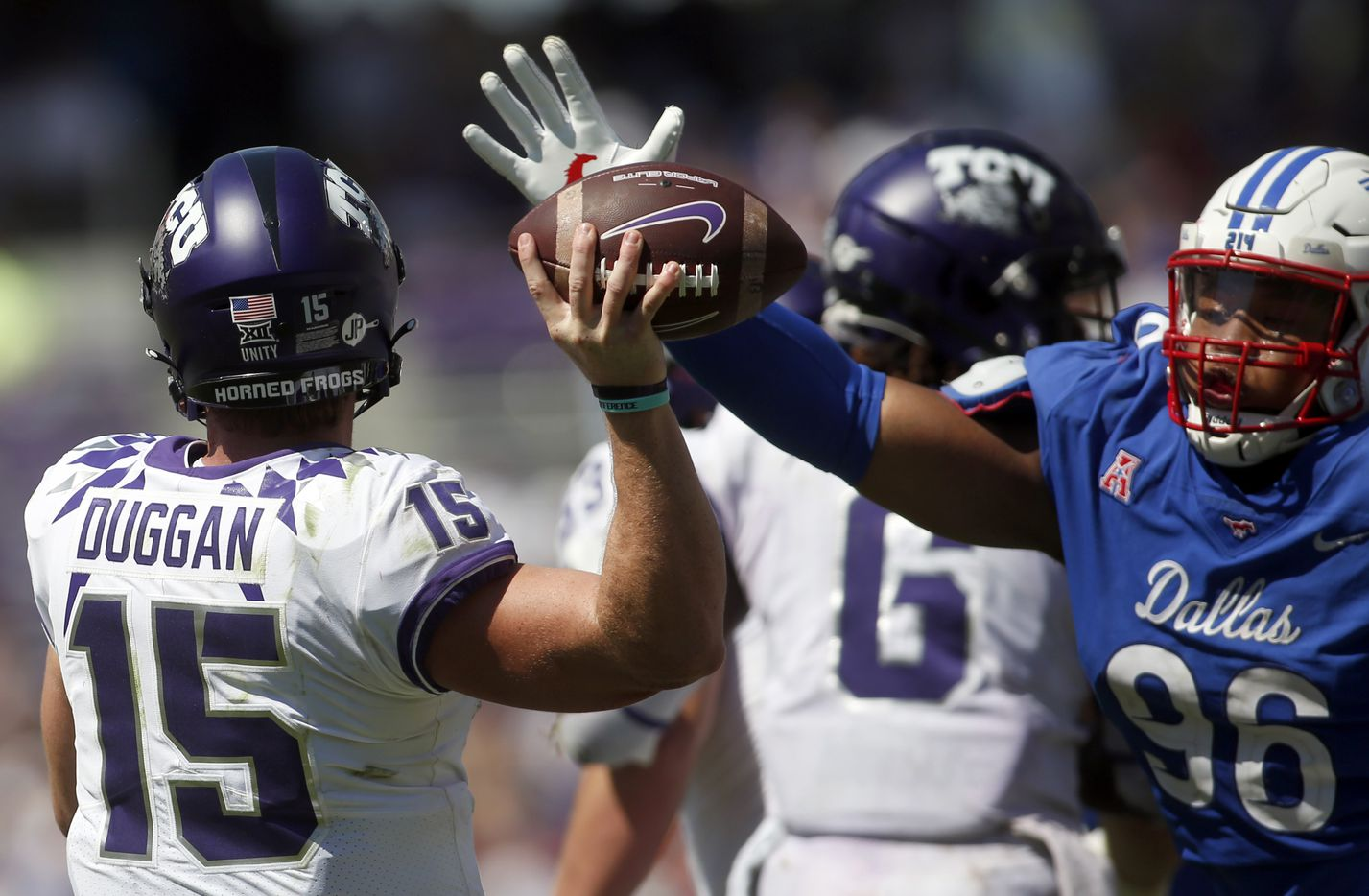 TCU quarterback Max Duggan (15) narrowly missed getting this pass blocked by SMU defensive tackle DeVere Levelston (96) during 4th quarter action. SMU won 42-34. The two teams played their NCAA football game at Amon G. Carter Stadium on the campus of TCU in Fort Worth on September 25, 2021. (Steve Hamm/ Special Contributor)