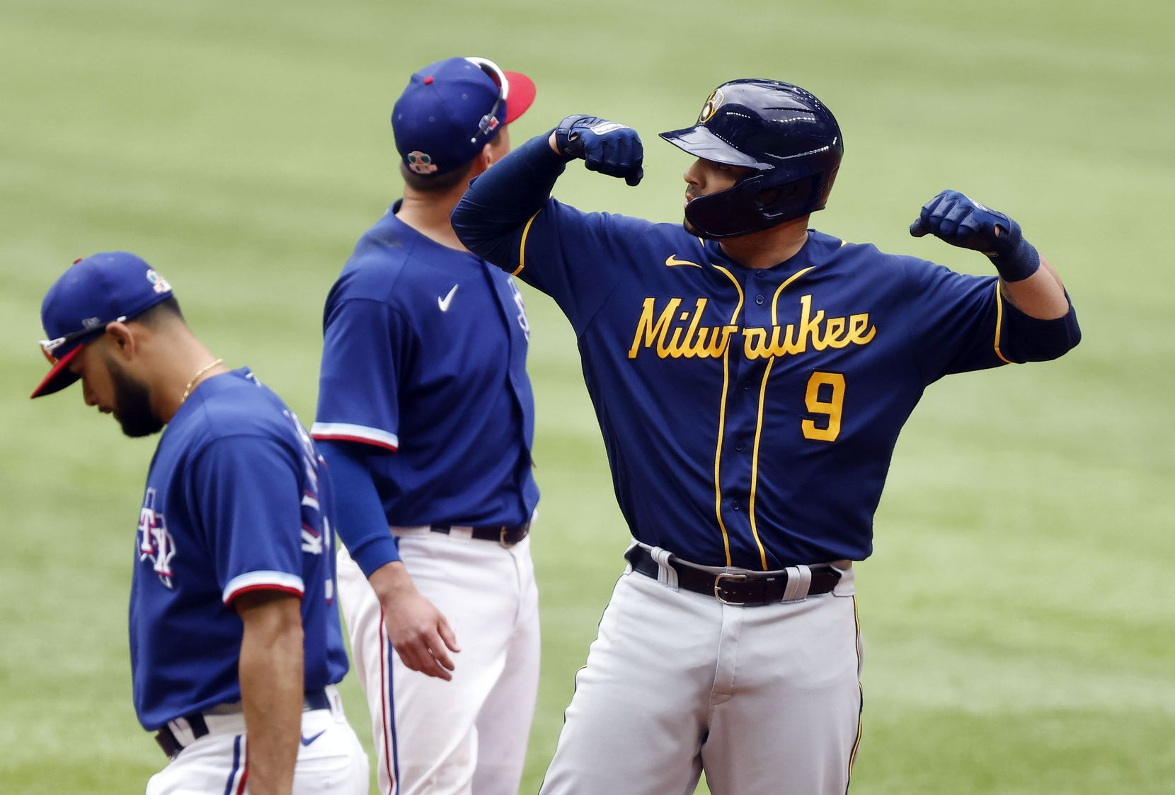 Milwaukee Brewers batter Manny Pina (9) flexes after making it to second on a single to center in the third inning at Globe Life Field in Arlington, Texas. The teams were playing in an exhibition game, Tuesday, March 30, 2021. Milwaukee Brewers Daniel Vogelbach scored on the hit.  (Tom Fox/The Dallas Morning News)