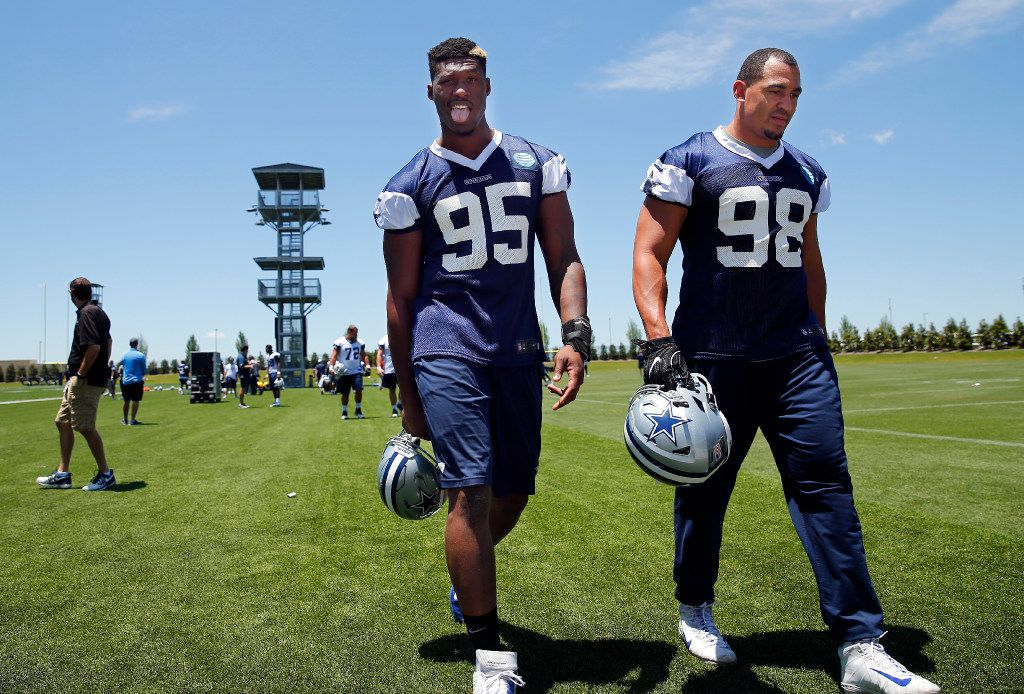 Dallas Cowboys defensive tackle David Irving (95) sticks his tongue out as he and defensive end Tyrone Crawford (98) leave the field following organized team activities at The Star in Frisco, Texas, Wednesday, May 24, 2017. (Tom Fox/The Dallas Morning News)