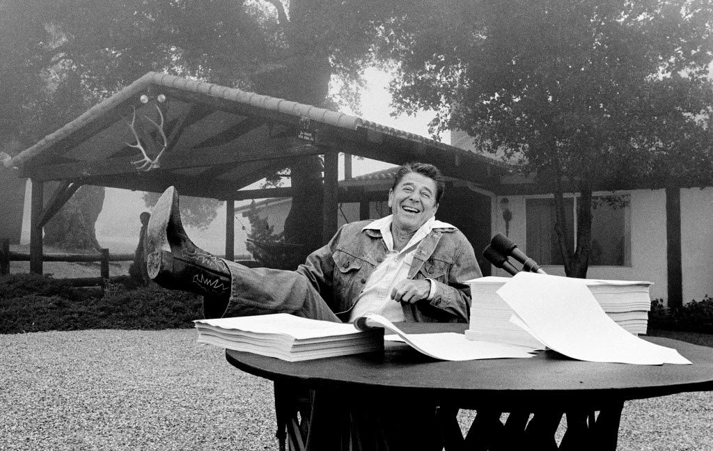 President Ronald Reagan signed his tax bill into law at his California vacation home, Rancho del Cielo, near Santa Barbara. (File Photo/The Associated Press)