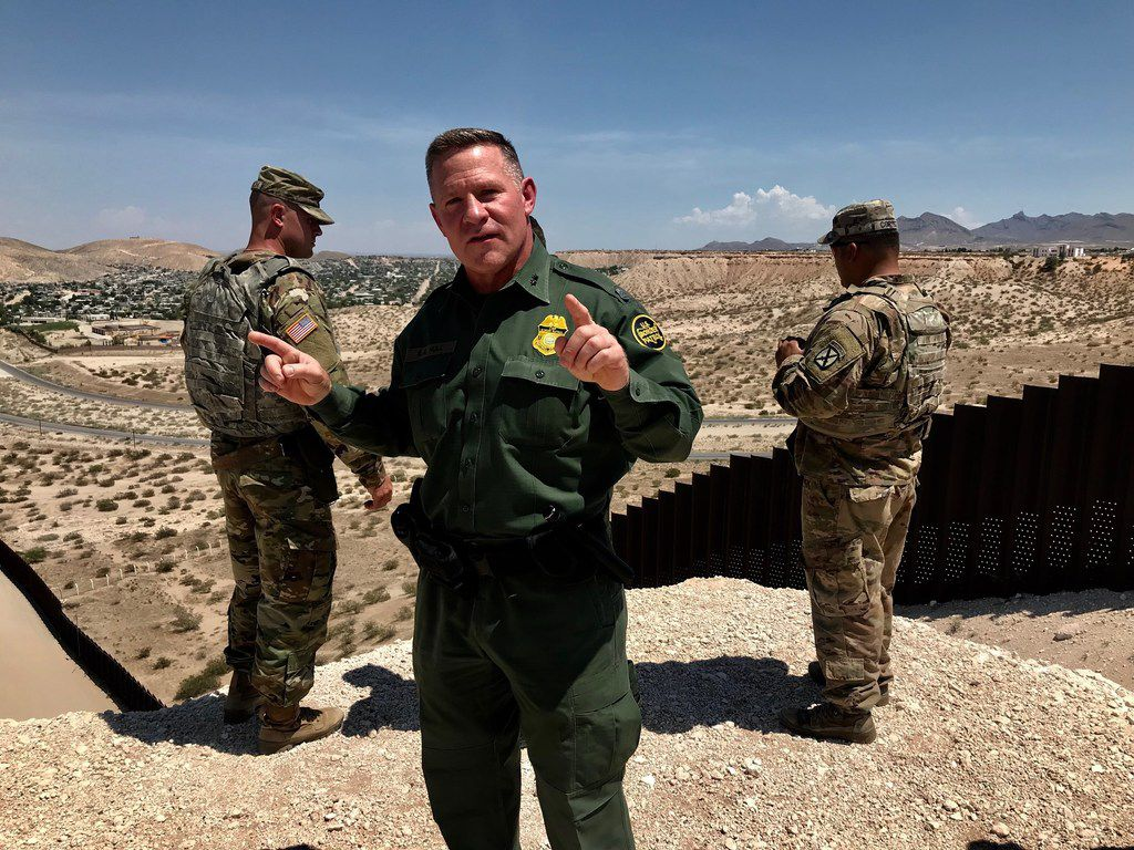 Aaron Hull, Border Patrol Chief of the El Paso sector, answers questions along the border fence in Sunland Park, New Mexico, on July 18th.