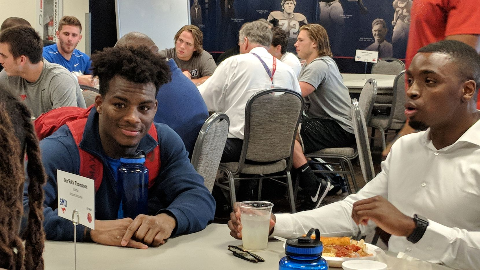 Former SMU receiver Der'Rikk Thompson speaks to current student-athletes like James Proche at SMU's Life After Ball seminar on Wednesday, April 11, 2018.