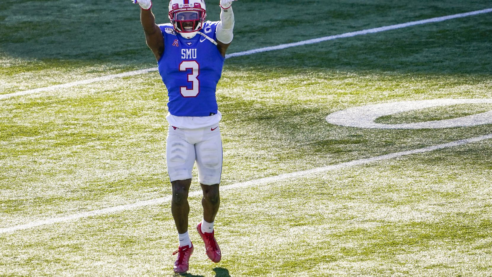 FILE - SMU wide receiver James Proche celebrates a touchdown catch by receiver Myron Gailliard during the first half of a game against Tulane at Ford Stadium on Saturday, Nov. 30, 2019, in Dallas.