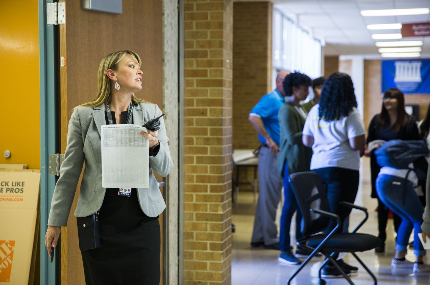 Thomas Jefferson High School Principal Sandi Massey supervises students as they make their way to their next class at Thomas A. Edison Middle School, where they started classes on Wednesday, October 23, 2019 in Dallas. Jefferson High School was severely damaged when multiple tornadoes ripped through the DFW area on Sunday night. Students are expected to have classes at the Edison campus for the rest of the school year. (Ashley Landis/The Dallas Morning News)