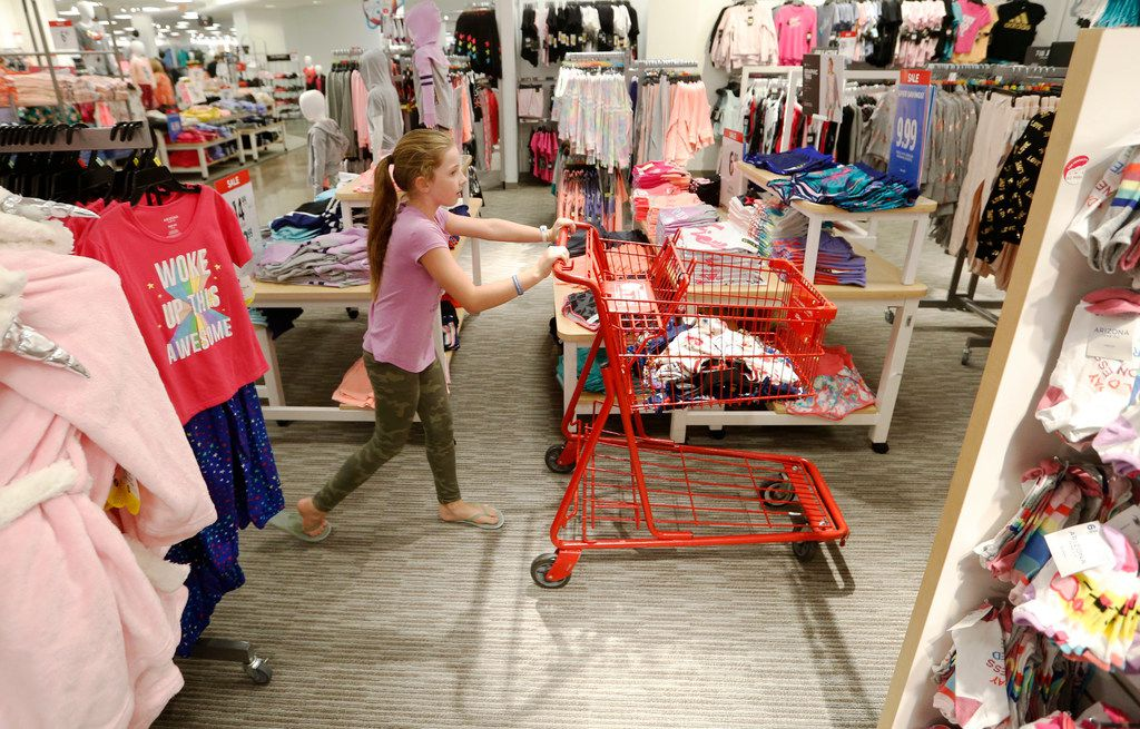Brianna Foster, 9 of Lucas pushes the cart as she shopped in July for her back to school clothes with her grandmother, Joni McConnell of Frisco, at J.C. Penney in Frisco.