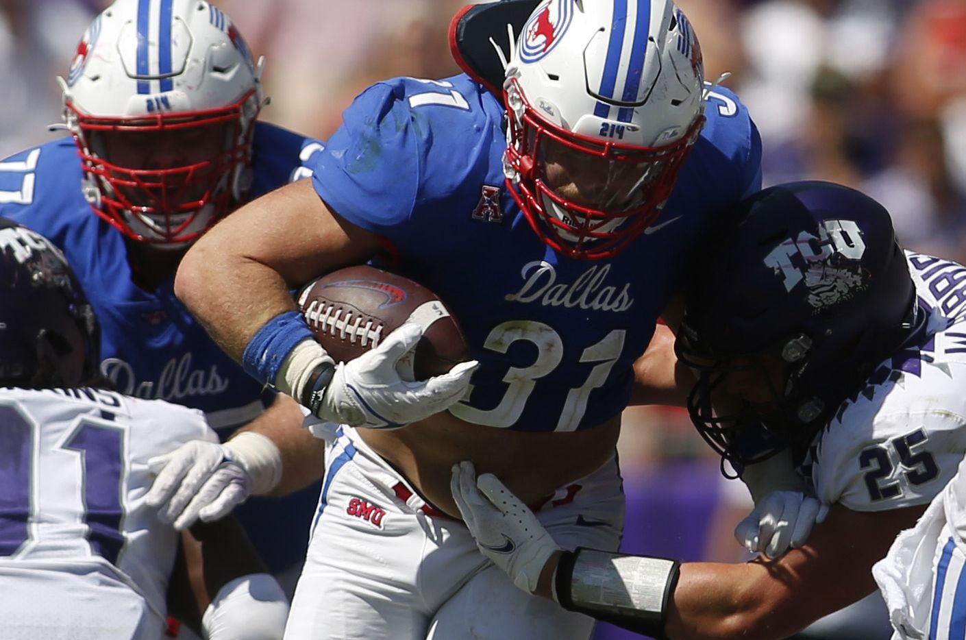 SMU running back Tyler Lavine (31) breaks into the secondary as TCU linebacker Wyatt Harris (25) moves in to make the tackle during 4th quarter action. SMU won 42-34.
