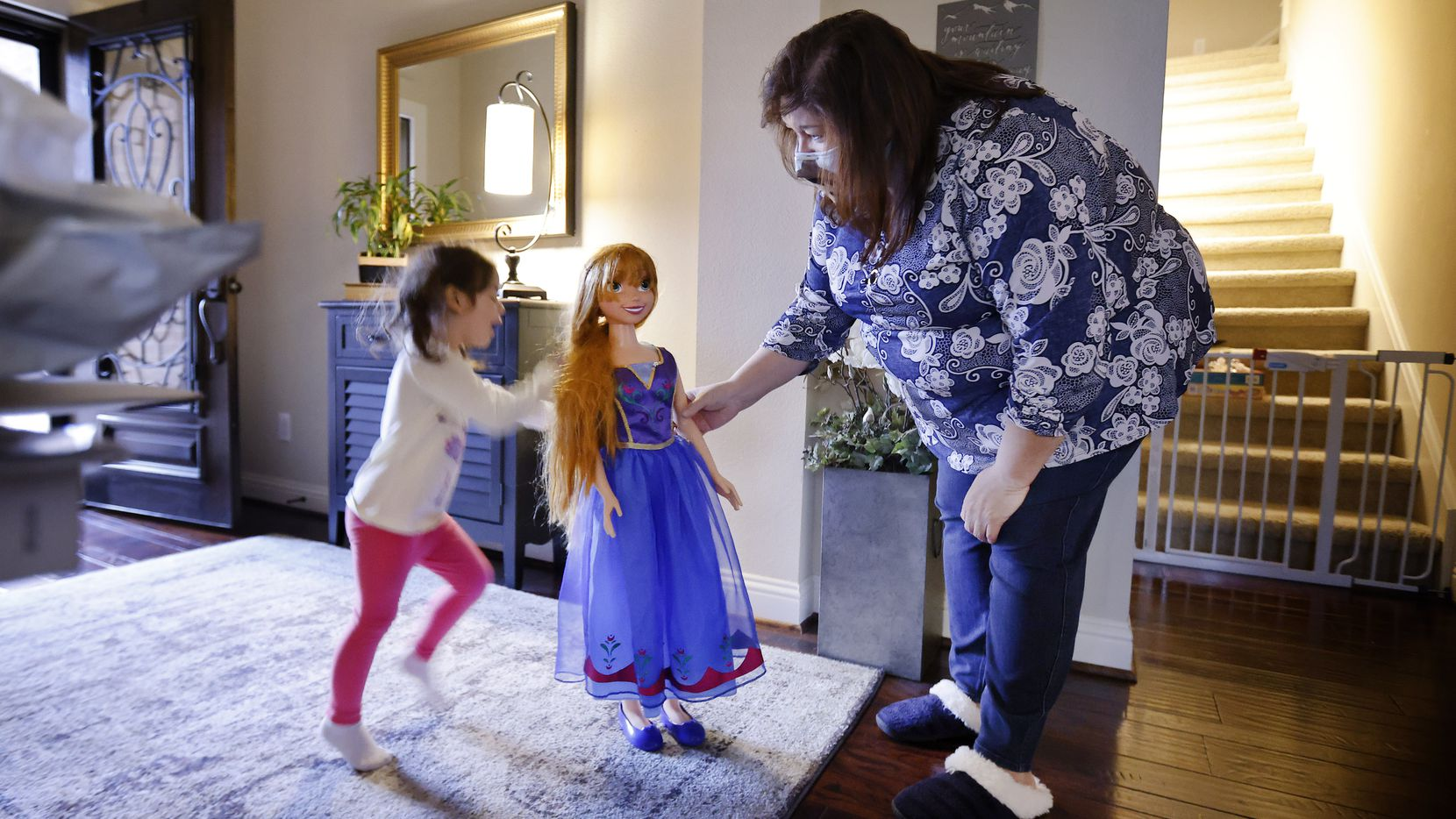 "Carmen Lozoya (right) of Fort Worth plays with granddaughter Esme Bueno Galindo and an Anna doll, based on a princess from the movie ""Frozen."" Lozoya has an overnight visit from the 3-year-old every weekend."