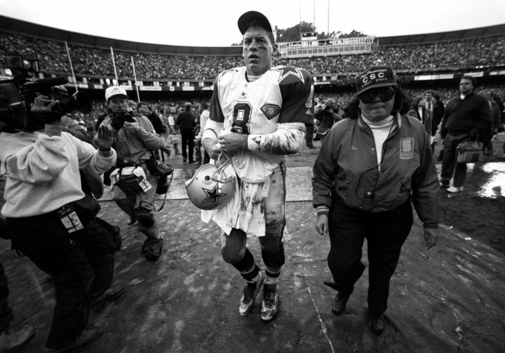 Dallas Cowboys QB Troy Aikman (8)  leaves the field after the Cowboys loss to the San Francisco 49' ers at the 1995 NFC Championship game. (Taken 1-15-95)