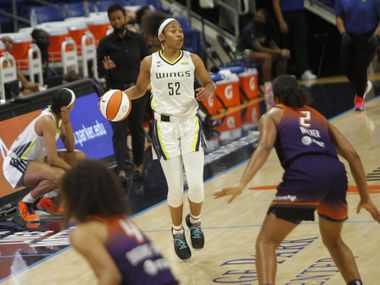 Dallas Wings guard Tyasha Harris (52) looks to pass as she sets up an offensive play during first half action against Phoenix. The Dallas Wings hosted the Phoenix Mercury for their WNBA game held at UTA's College Park Center in Arlington on May 29, 2021.