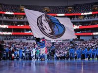 Dallas Mavericks mascot Champ waves the team flag prior to player introductions before facing the Utah Jazz at the American Airlines Center in Dallas, Wednesday, October 6, 2021. The Mavericks defeated the Jazz, 111-101.