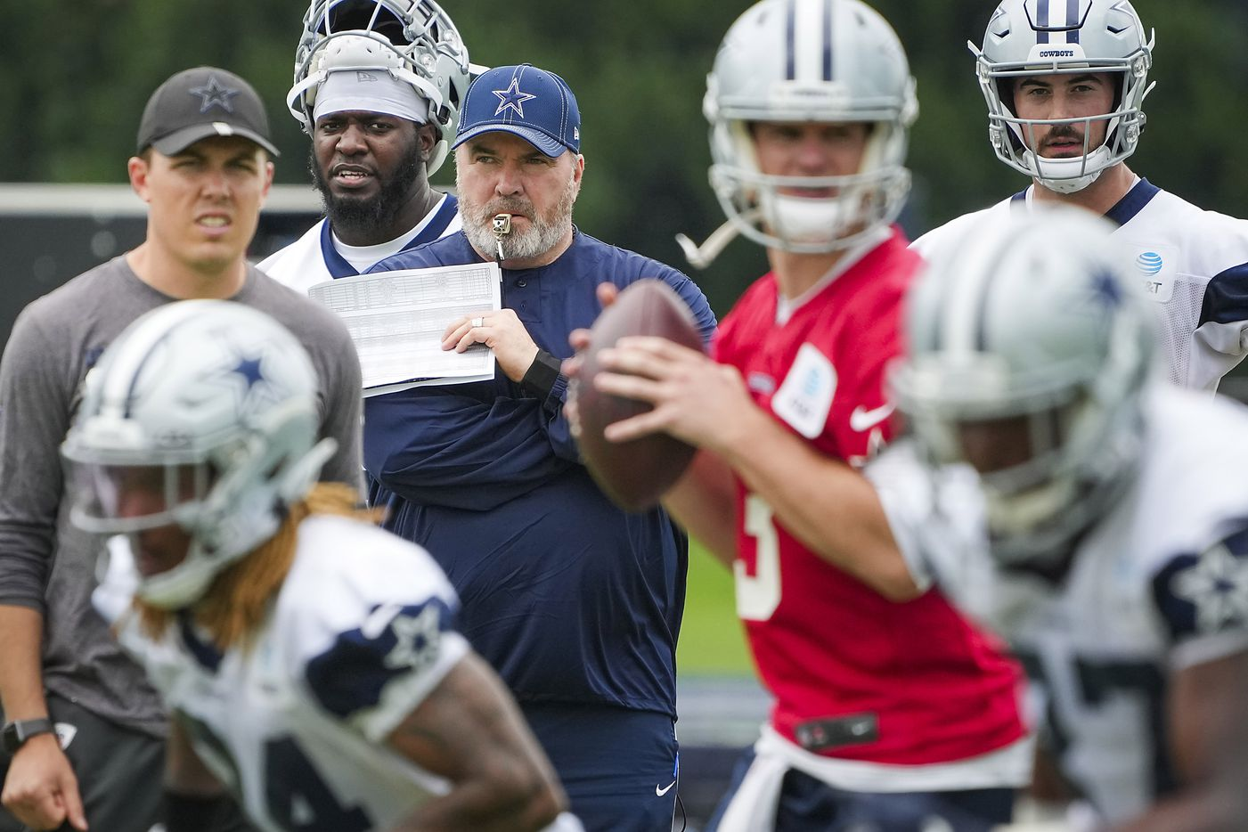 Dallas Cowboys head coach Mike McCarthy )(center) and offensive coordinator Kellen Moore (left) watch quarterback Garrett Gilbert (3) run the offense in a drill during a minicamp practice at The Star on Wednesday, June 9, 2021, in Frisco. (Smiley N. Pool/The Dallas Morning News)