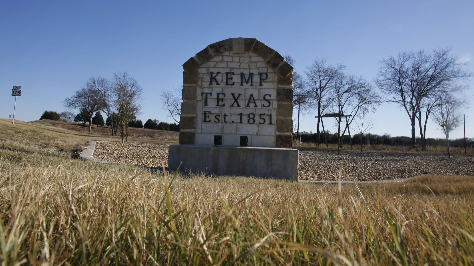 A stone marker stands at the exit from US 175 to Kemp, Texas. (Guy Reynolds/The Dallas Morning News)