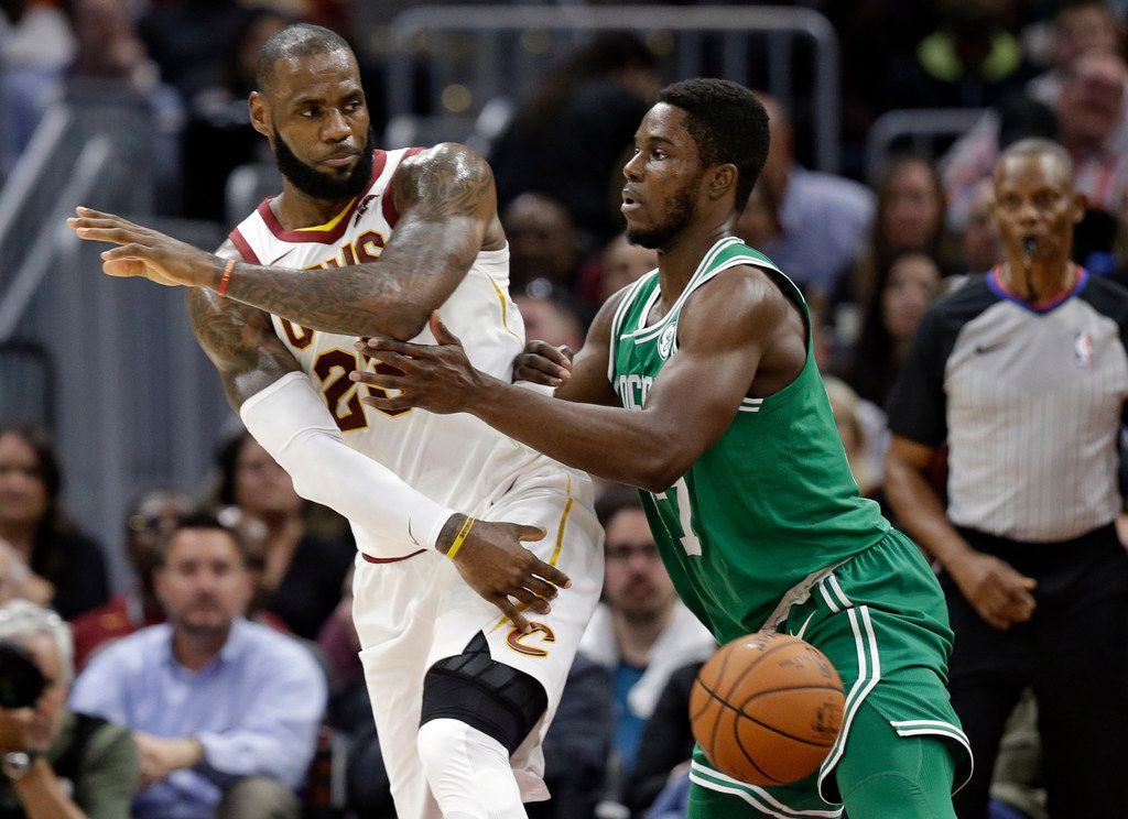 Cleveland Cavaliers' LeBron James, left, passes against Boston Celtics' Semi Ojeleye in the first half of an NBA basketball game, Tuesday, Oct. 17, 2017, in Cleveland. (AP Photo/Tony Dejak)