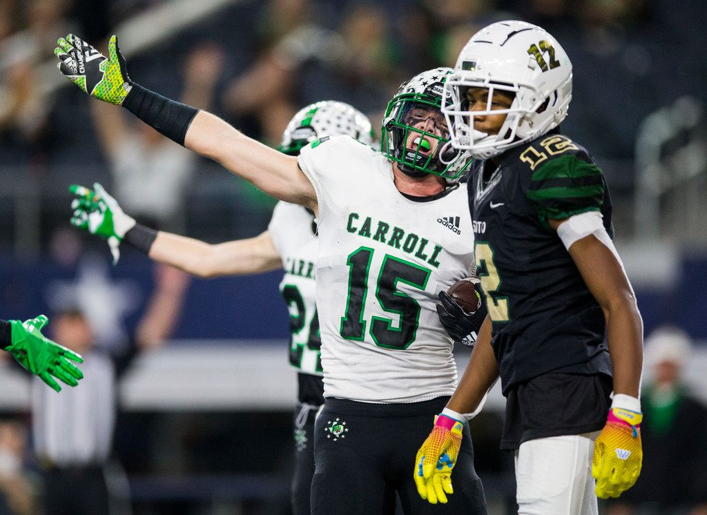 Southlake Carroll defensive back Brandon Howell (15) signals a turnover after he intercepted a pass in the end zone intended for DeSoto wide receiver Jaedon Wilson (12) during the third quarter of a Class 6A Division I area-round high school football playoff game between Southlake Carroll and DeSoto on Friday, November 22, 2019 at AT&T Stadium in Arlington. (Ashley Landis/The Dallas Morning News)